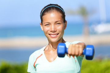 Fitness woman lifting dumbbell weight training
