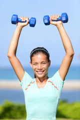 Fitness woman weight training outside