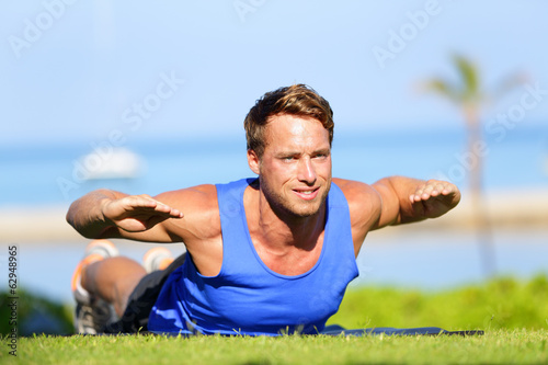 Fitness man training back extension exercise
