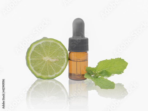 Dropper bottle with kaffir lime and mint leaves