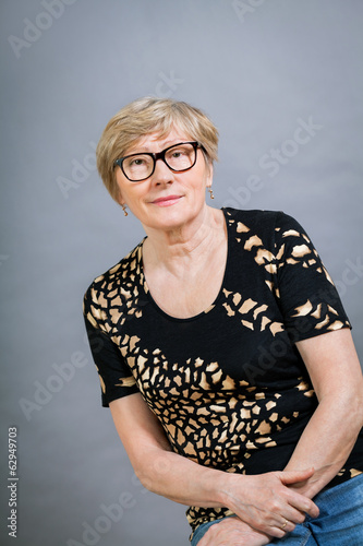 Attractive blond senior woman wearing glasses