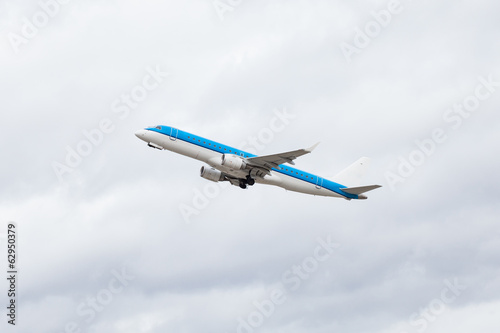 Commercial airliner flying midair after takeoff