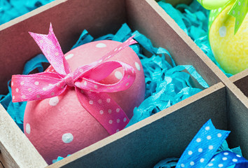 easter eggs in a wooden box