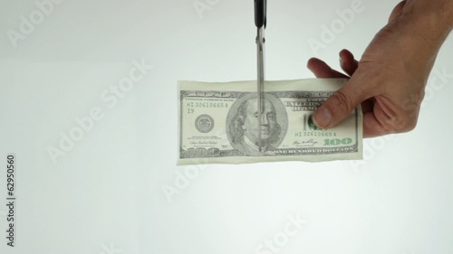 cutting hundred dollars note