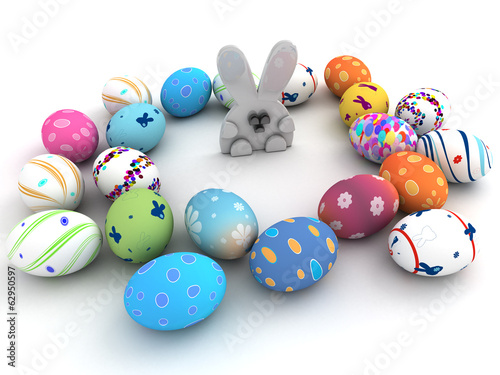 Easter bunny and colorful eggs isolated on white background