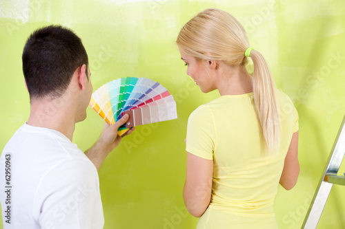 couple  with color samples to paint