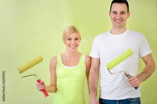 Happy love couple with equipment for painting