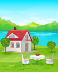 River House with mountain views. Table and chairs on the lawn at