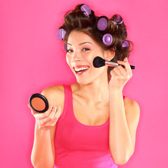 Make-up - woman putting makeup blush