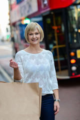 Trendy woman holding shopping bag