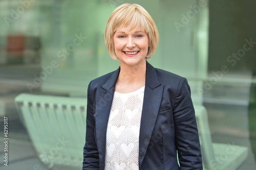 Smiling female executive posing confidently