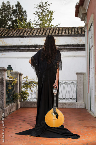 beautiful woman dressed as a fado performer