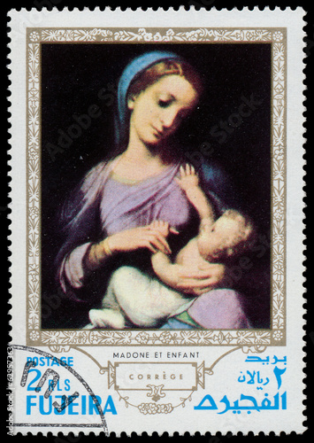 Stamp printed in Fujeira shows Madonna with child