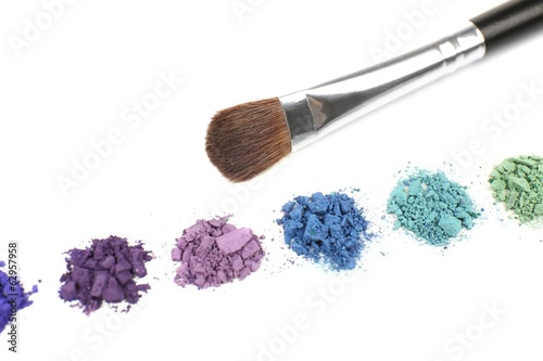 Colorful crushed eyeshadow and professional make-up brush