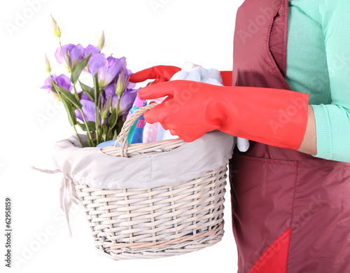 Housewife holding basket with cleaning equipment. Conceptual