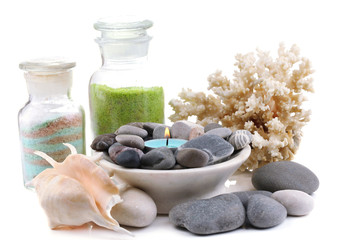 Spa stones with candle, coral and sea salt, isolated on white