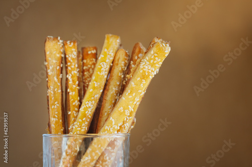 Bread sticks  with cheese and sesame in the glass, cose up
