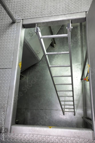 metal ladder in high tech stainless steel space