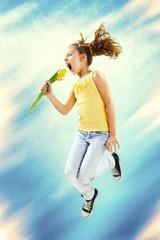 Rock your spring, little girl jump, holding flower