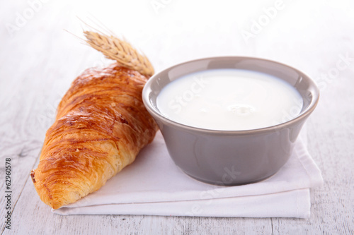 bowl of milk and croissant