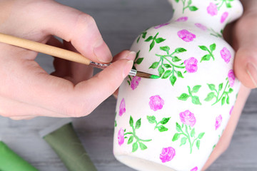 Hand paints on hand made vase and art materials