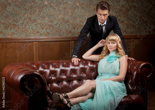 attractive young couple in retro interior