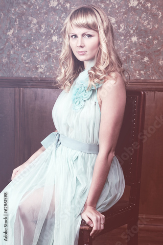 attractive young blond woman in vintage interior