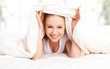 funny beautiful young blond woman under the blanket
