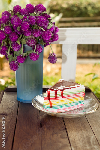 flowers and rainbow cake on terrace