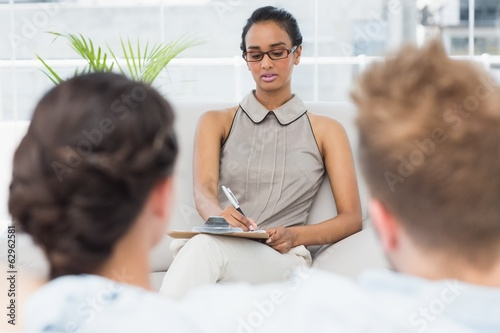 Therapist talking with couple on the couch
