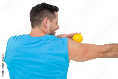 Rear view of a content young man holding stress ball