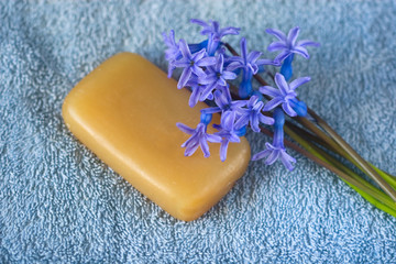 piece of natural soaps and fragrant bouquet of spring flowers