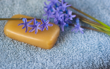 flower on a piece of natural soap and bouquet of flowers