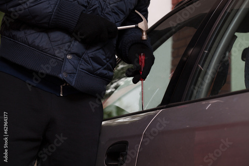 Car break-in closeup