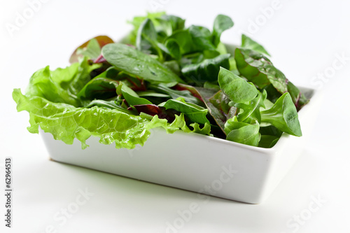 mixed salad on white table