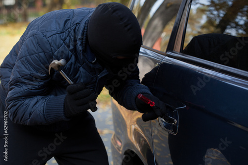 Masked burglar with hammer