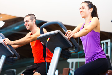 Group of people doing fitness in a gym