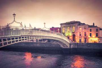 Vintage style historic Ha'penny Bridge, Dublin Ireland at dusk