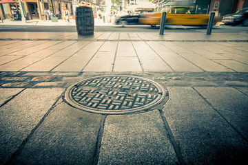 Manhole drain cover on streets of lower Manhattan