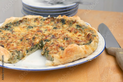 French quiche with spinach, cheese, minced meat