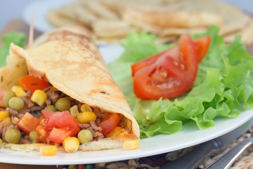 Homemade tortilla wrap (pancakes) with minced meat