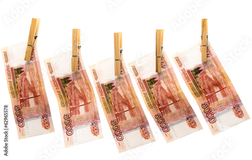 Five thousand roubles on clothespins on white background