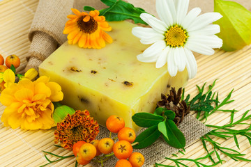 Composition from natural soap,different  berries and flowers