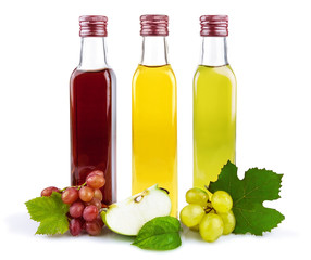 Three glass bottles of vinegar