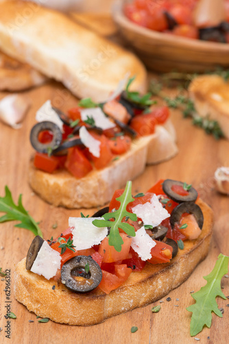 ciabatta with tomatoes, olives, parmesan cheese and herbs