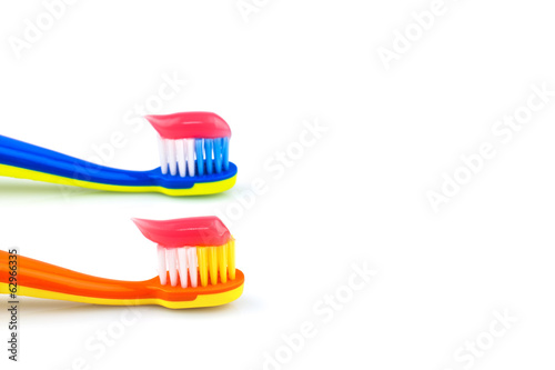 Colorful toothbrushes with toothpaste