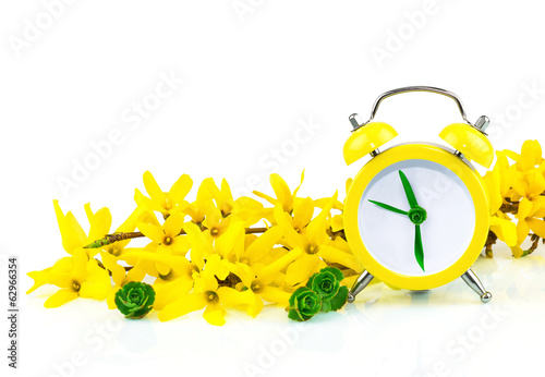 Spring yellow concept with clock and flowers
