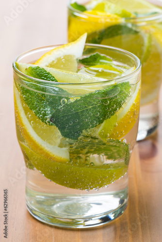 Cold fresh lemonade with lemon, lime and mint in glass