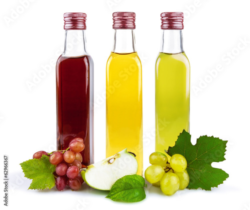 Three glass bottles of vinegar