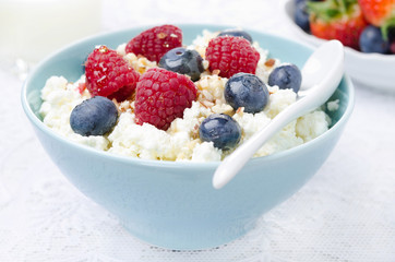 cottage cheese with berries, honey and nuts, fresh berries